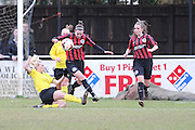 Deanna Cooper rides a challenge to clear the danger during the Women's FA Cup match between Watford Ladies FC and Brighton Ladies at the Broadwater Stadium, Berkhampstead, United Kingdom on 1 February 2015. Photo by Stuart Butcher.
