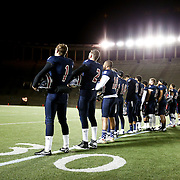 Members of the Boston Brawlers line up to listen to the National Anthem prior to the first ever Boston Brawlers home game at Harvard Stadium on October 24, 2014 in Boston, Massachusetts. (Photo by Elan Kawesch)