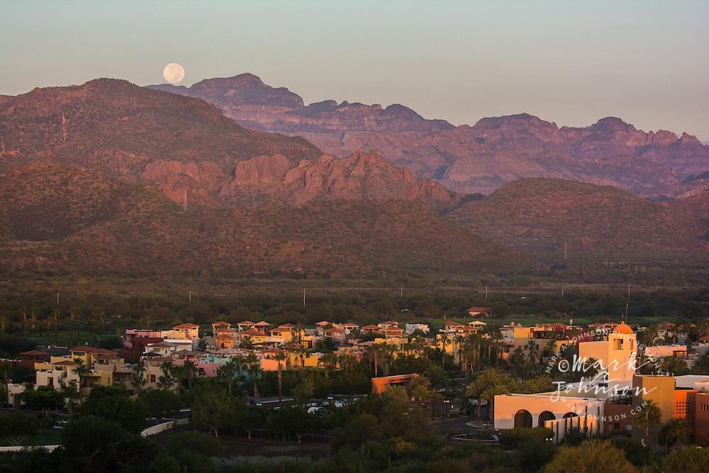 The full moon setting behind the Sierra de los Gigante mountain range, Loreto, Baja California Sur, Mexico