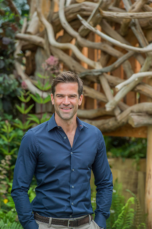 Gethin Jones, raisng awareness of Autism on the Zoflora and Caulkdwell Childrens wild Garden by Adam White and Andree Davies - The Hampton Court Flower Show, organised by the Royal Horticultural Society (RHS). In the grounds of the Hampton Court Palace, London.
