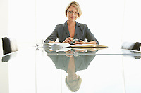 Businesswoman at conference table portrait