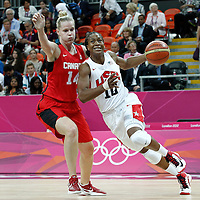 07 August 2012: USA Tamika Catchings drives past Canada Tina Charles during 91-48 Team USA victory over Team Canada, during the women's basketball quarter-finals, at the Basketball Arena, in London, Great Britain.