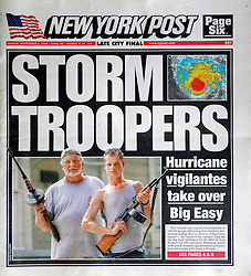 1st Sept 2008. New Orleans, Louisiana.<br /> New York Post. Front Page. <br /> My neighbours make the front page of the New York Post as they prepare to batton down the hatches for hurricane Gustav.They're armed, staying  and deadly serious. You loot, they shoot.<br /> Photo; Charlie Varley.