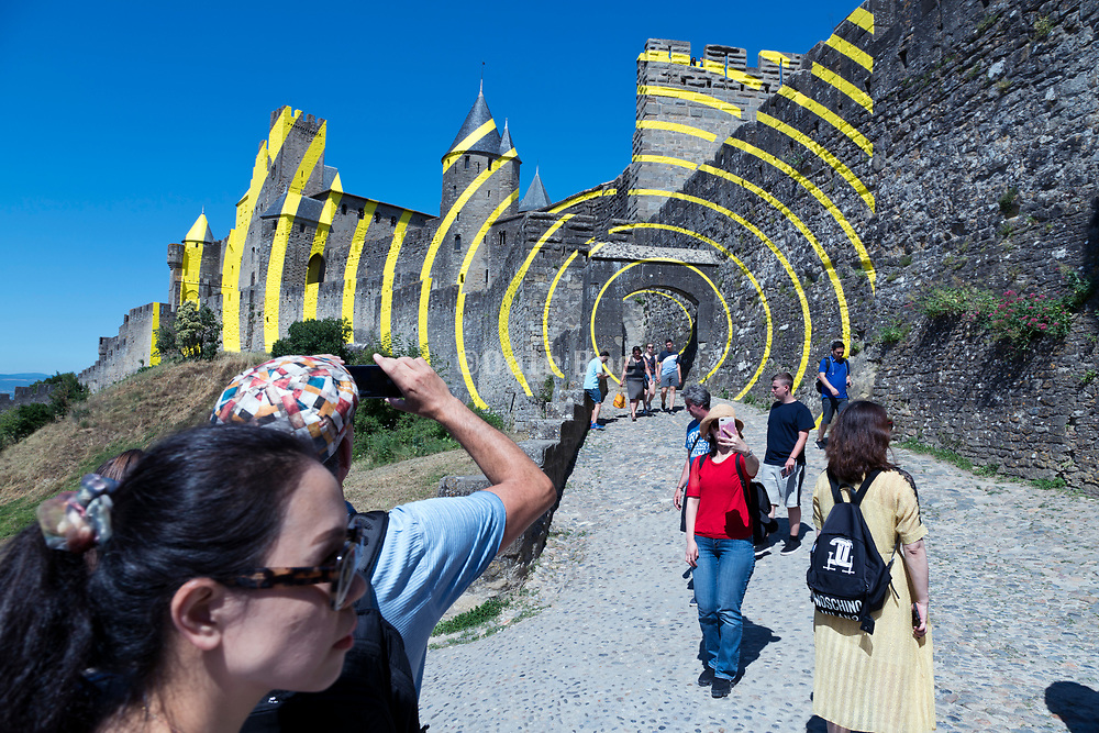 Tourist destination La Cite in Carcassonne France.with concentric circles art by artist Felice Varini