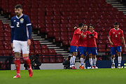 23rd March 2018, Hampden Park, Glasgow, Scotland; International Football Friendly, Scotland versus Costa Rica; Marco Urena of Costa Rica is congratulated after scoring