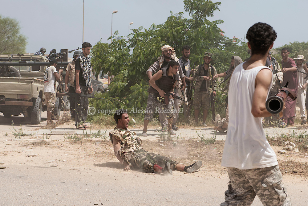 Libya: a fighter affiliated with Libya's Government of National Accord's (GNA) shouts right after being shot on his leg during clashes with ISIS in 700 neighbourhood in Sirte. Alessio Romenzi