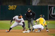 Oakland Athletics left fielder Khris Davis (2) beats the tag by Baltimore Orioles second baseman Jonathan Schoop (6) on a double to left field during the fourth inning at Oakland Coliseum in Oakland, Calif. on August 8, 2016. (Stan Olszewski/Special to S.F. Examiner)