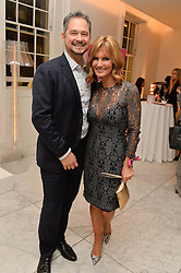 TV presenter JACQUIE BELTRAO and her husband EDUARDO BELTRAO at the Melissa Odabash & Future Dreams Preview to launch their collaborative mastectomy swimwear line in aid of the future dreams Haven appeal held at Fenwick, New Bond Street, London on 10th February 2015.