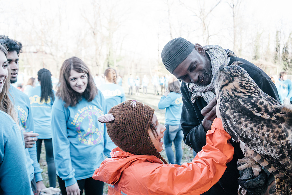 Seventh-grader Sophia Riazi-Sekowski, 11, pets Hoots, a Eurasian eagle owl at the annual Lower Beaverdam Creek cleanup on March 17, 2016 in Hyattsville, Md.