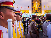 05 DECEMBER 2013 - BANGKOK, THAILAND:  Thai military cadets stand in formation in front of the stage with a large portrait of the King at his birthday celebration. Thais observed the 86th birthday of Bhumibol Adulyadej, the King of Thailand, their revered King on Thursday. They held candlelight services throughout the country. The political protests that have gripped Bangkok were on hold for the day, although protestors did hold their own observances of the holiday. Thousands of people attended the government celebration of the day on Sanam Luang, the large public space next to the Grand Palace in Bangkok.    PHOTO BY JACK KURTZ