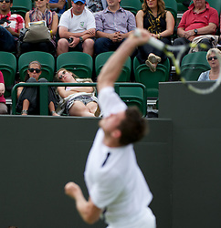 LONDON, ENGLAND - Monday, June 25, 2012: A spectator sleeps as Josh Goodall (GBR) takes on Grega Zemlja (CRO) during the Gentleman's Singles 1st Round on the opening day of the Wimbledon Lawn Tennis Championships at the All England Lawn Tennis and Croquet Club. (Pic by David Rawcliffe/Propaganda)