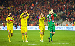 BRUSSELS, BELGIUM - Sunday, November 16, 2014: Wales' Joe Ledley, Aaron Ramsey, Gareth Bale and goalkeeper Wayne Hennessey celebrate a point and staying top of the group after the final whistle of a goal-less draw against Belgium during the UEFA Euro 2016 Qualifying Group B game at the King Baudouin [Heysel] Stadium. (Pic by David Rawcliffe/Propaganda)