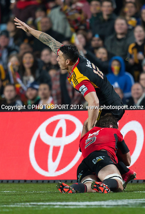 Chiefs' Sonny Bill Williams is tackled by Crusaders' Samuel Whitelock during the Super Rugby Semi Final won by the Chiefs (20-17) against the Crusaders at Waikato Stadium, Hamilton, New Zealand, Friday 27 July 2012. Photo: Stephen Barker/Photosport.co.nz