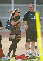 NOVI SAD, SERBIA - Monday, September 10, 2012: Wales' Medical Officer Doctor Mark Ridgewell and Vauxhall's Hannah Lupton during a training session at the Karadorde Stadium ahead of the 2014 FIFA World Cup Brazil Qualifying Group A match against Serbia. (Pic by David Rawcliffe/Propaganda)