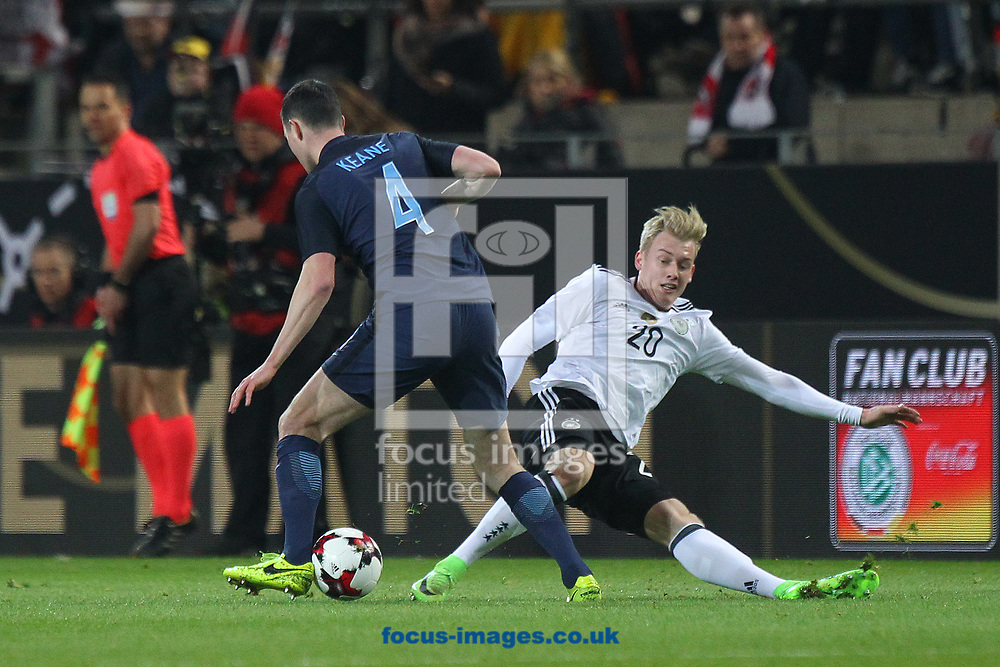Michael Keane of England and Julian Brandt of Germany in action during the International Friendly match at Signal Iduna Park, Dortmund<br /> Picture by Paul Chesterton/Focus Images Ltd +44 7904 640267<br /> 22/03/2017