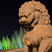 Asia, China, Beijing, Stone lions at the Gate of Heavenly Peace in the Forbidden City at dusk on summer evening