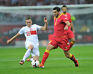 Montenegro's Milos Krkotic and Piotr Zielinski of Poland during the FIFA World Cup 2014 group H qualifying football match of Poland vs Montenegro on September 6, 2013 in Warsaw, <br />