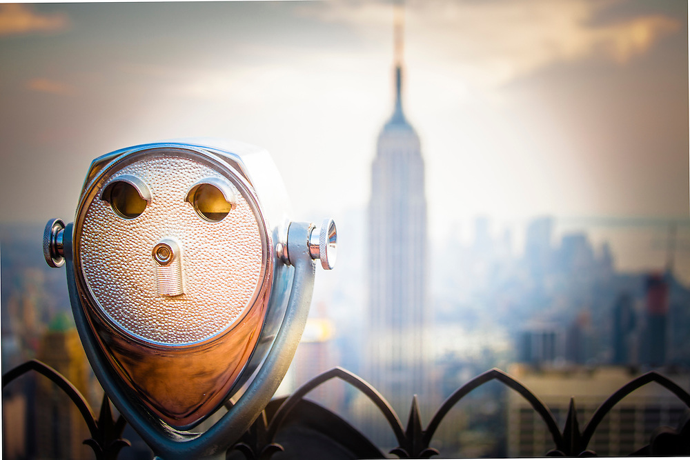A binocular viewer at the Top Of The Rock observation deck at 30 Rock in Rockefeller Center resembles a face, and overlooks a spectacular view of the Manhattan skyline including, at center, the Empire State Building. <br />