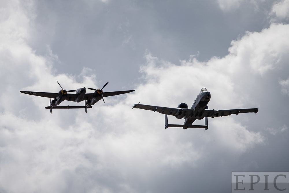 RENO, NV - SEPTEMBER 14: An A-10 Thunderbolt II and a WWII P-38 Lightening perform a flyover at the Reno Championship Air Races  on September 14, 2017 in Reno, Nevada. (Photo by Jonathan Devich/Getty Images) *** Local Caption ***