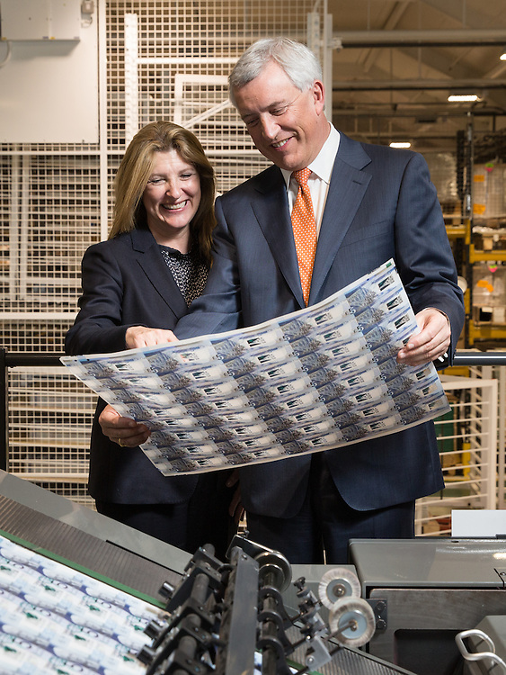 David Duffy CEO Clydesdale Bank and Ruth Euling, Global Account Sales Director at DeLaRue at DeLaRue, Gateshead to see the new &pound;5 polymer notes with his signature on it.  Picture Robert Perry 10th Feb 2016<br /> <br /> Please credit photo to Robert Perry<br /> <br /> Image is free to use in connection with the promotion of the above company or organisation. 'Permissions for ALL other uses need to be sought and payment make be required.<br /> <br /> <br /> Note to Editors:  This image is free to be used editorially in the promotion of the above company or organisation.  Without prejudice ALL other licences without prior consent will be deemed a breach of copyright under the 1988. Copyright Design and Patents Act  and will be subject to payment or legal action, where appropriate.<br /> www.robertperry.co.uk<br /> NB -This image is not to be distributed without the prior consent of the copyright holder.<br /> in using this image you agree to abide by terms and conditions as stated in this caption.<br /> All monies payable to Robert Perry<br /> <br /> (PLEASE DO NOT REMOVE THIS CAPTION)<br /> This image is intended for Editorial use (e.g. news). Any commercial or promotional use requires additional clearance. <br /> Copyright 2016 All rights protected.<br /> first use only<br /> contact details<br /> Robert Perry     <br /> 07702 631 477<br /> robertperryphotos@gmail.com<br />        <br /> Robert Perry reserves the right to pursue unauthorised use of this image . If you violate my intellectual property you may be liable for  damages, loss of income, and profits you derive from the use of this image.