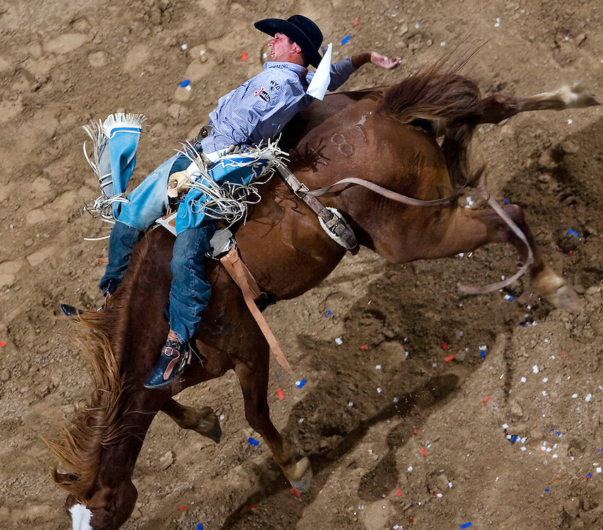 Andy Martinez of Pavillion, Wyoming competes in the Bareback Riding during Thursday edition of the Days of 47 Rodeo at the Delta Center in Salt Lake City Utah July 19, 2007.  August Miller/ Deseret Morning News