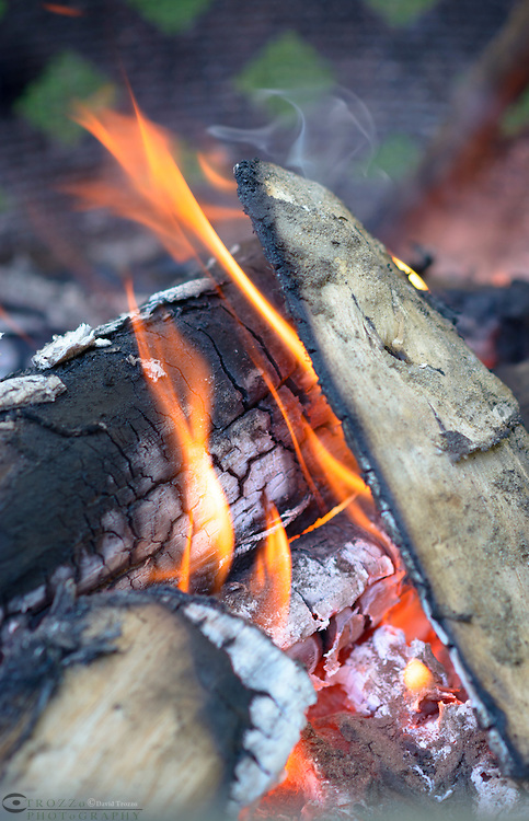 Low burning flame of a campfire.