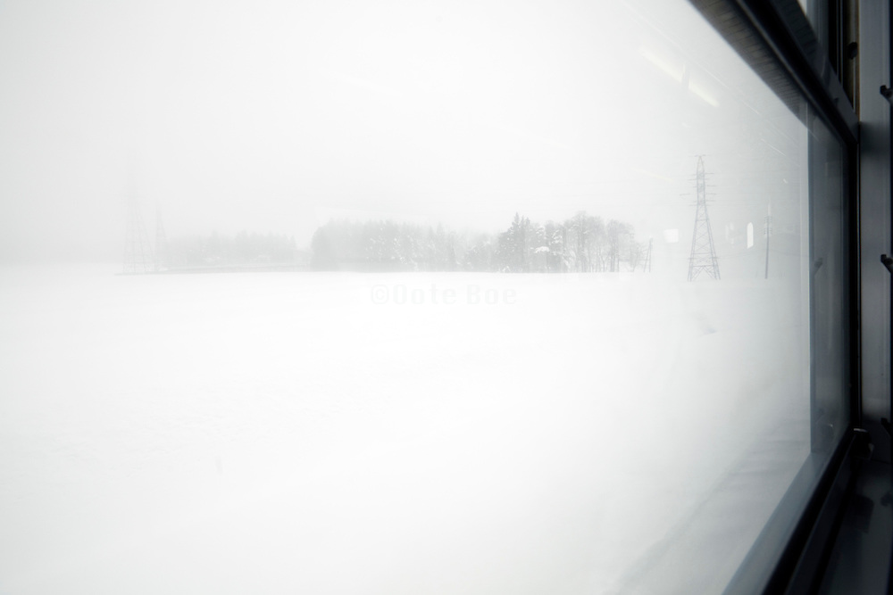 wintry snow covered landscape seen from train Japan from Nagano to Naoetsu