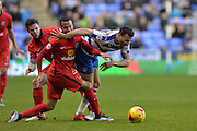 Reading FC midfielder Hal Robson-Kanu trying to get past Blackburn Rovers defender Markus Olsson during the Sky Bet Championship match between Reading and Blackburn Rovers at the Madejski Stadium, Reading, England on 3 December 2015. Photo by Mark Davies.