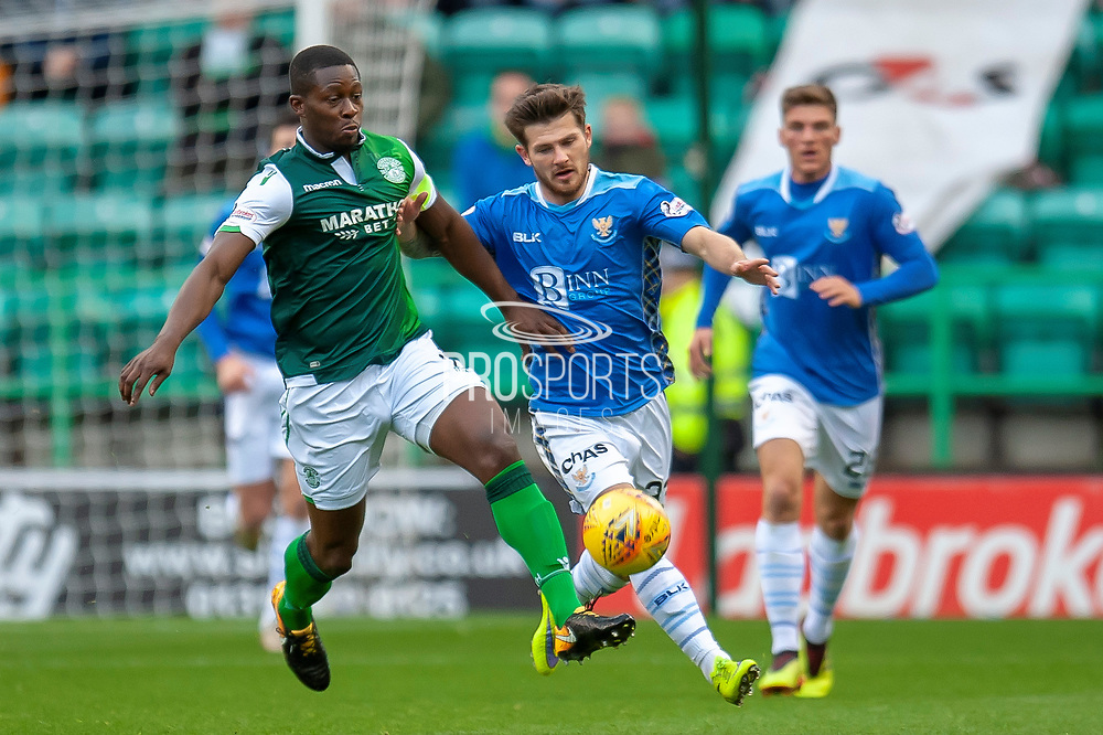 Marvin Bartley (#6) of Hibernian FC holds off Matthew Kennedy (#33) of St Johnstone FC during the Ladbrokes Scottish Premiership match between Hibernian and St Johnstone at Easter Road, Edinburgh, Scotland on 3 November 2018.