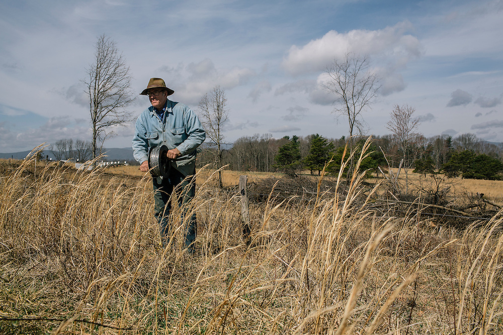 SWOOPE, VA - MARCH 26 Pasture-based farmer Joel Salatin changes the paddocks at Polyface Farms in Swoope, Va. on March 26, 2015. Salatin is one of the heroes of the sustainable-food movement, and he appeals to both left- and right-wing audiences.  (Photo by Greg Kahn/GRAIN for The Washington Post)