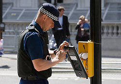 © licensed to London News Pictures. 23/05/2011. London, UK. Police search a traffic signal box to make it secure today (23/05/2011) in preparation  for the arrival of the U.S. president Barak Obama to the UK tomorrow. Photo credit should read: Ben Cawthra/LNP