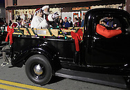 Pine Bush, New York - Santa Claus and Mrs. Claus wave to the crowd from the back of an antique truck during the parade down Main Street at the Community Country Christmas 2011 celebration on Dec. 3, 2011.
