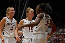 Dec 20, 2011; Stanford CA, USA;  Stanford Cardinal forward Nnemkadi Ogwumike (30) celebrates with guard Lindy La Rocque (15) and forward Taylor Greenfield (4) after a basket against the Tennessee Lady Volunteers during the second half at Maples Pavilion.  Stanford defeated Tennessee 97-80. Mandatory Credit: Jason O. Watson-US PRESSWIRE