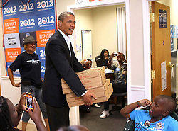 """President Barack Obama surprises workers at the """"Obama For America"""" Orlando field office with a stack of pizzas during an unannounced visit in Orlando, Florida, USA, Sunday, October 28, 2012. Photp by Joe Burbank/Orlando Sentinel/MCT/ABACAPRESS.COM  