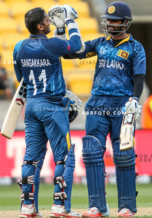 Kumar Sangakkara (l) and Lahiru Thirimanne celebrate and congratulate eachother after reaching the England score and winning the match during the 2015 ICC Cricket World Cup Pool A group match between England Vs Sri Lanka at the Wellington Regional Stadium, Wellington, New Zealand.