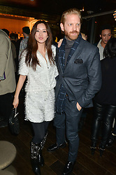 BETTY BACHZ and ALASTAIR GUY at a party hosted by Christian Lacroix partnered with Supa Model Management to celebrate London Men's Collections January 2015, held at the Rumpus Room, the roof top bar at the top of the Mondrian London, 20 Upper Ground, London SE1 on 12th January 2015.