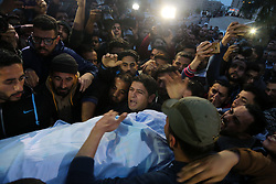 April 25, 2018 - Gaza, gaza strip, Palestine - People carry the body of Palestinian journalist Ahmed Abu Hussein, 24, who died of wounds he sustained while covering a protest along the Gaza-Israel border, at a hospital in the northern Gaza Strip, April 25, 2018. (Credit Image: © Majdi Fathi/NurPhoto via ZUMA Press)