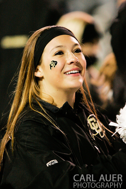 November 23rd, 2013:  A Colorado Cheerleader during the fourth quarter of the NCAA Football game between the University of Southern California Trojans and the University of Colorado Buffaloes at Folsom Field in Boulder, Colorado