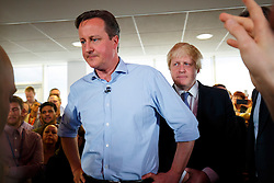 © Licensed to London News Pictures. 05/05/2015. LONDON, UK. Conservatives leader and Prime Minister David Cameron and Mayor of London Boris Johnson speaking to staff at Utility Warehouse in Hendon, northwest London on Tuesday, 5 May 2015. Photo credit : Tolga Akmen/LNP