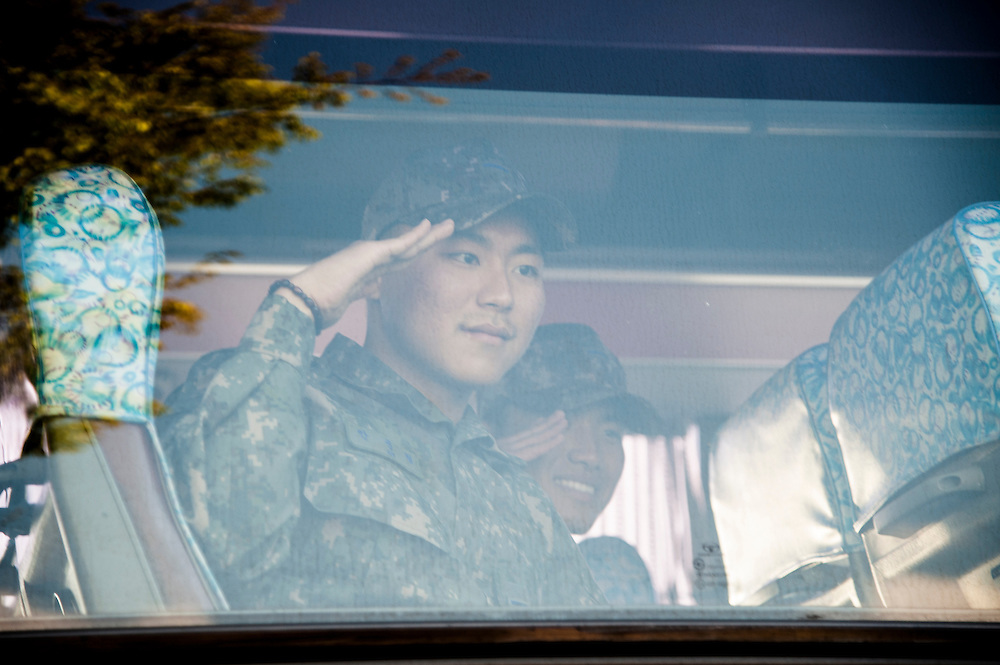 Members of the South Korean military, or Republic of Korea Armed Forces, said goodbye to family members in Busan as they boarded a bus to their base.