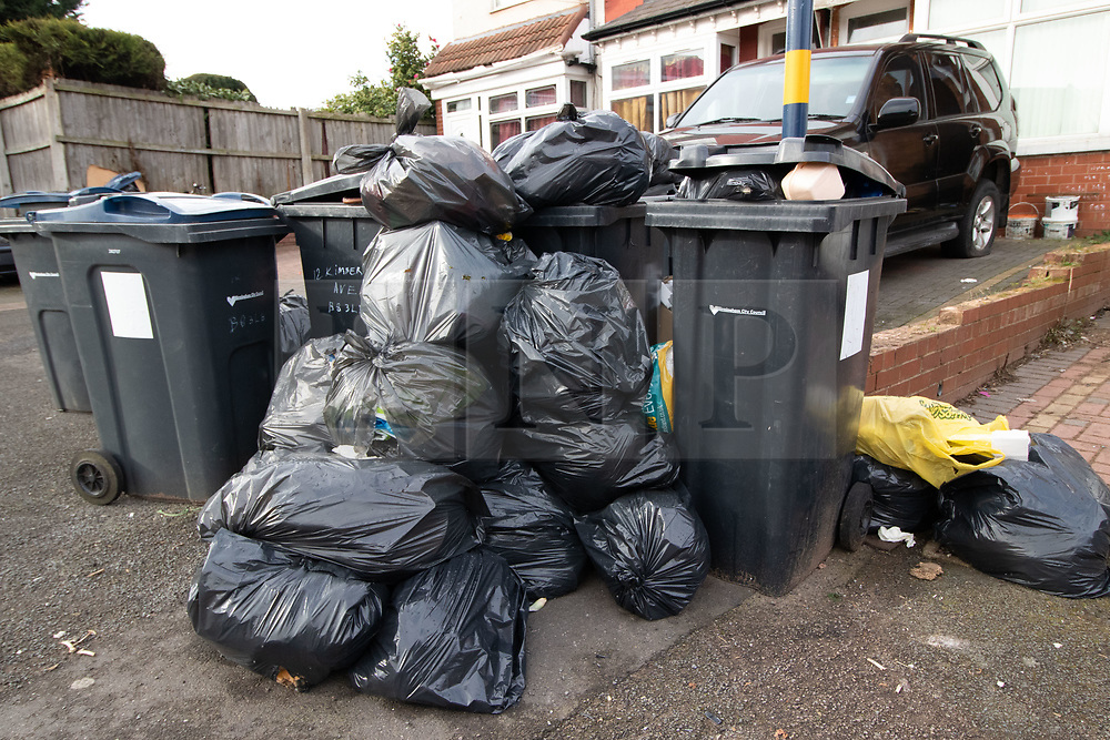 © Licensed to London News Pictures. 20/02/2019. Birmingham, UK. Birmingham bin men work to rule. Pictured, a large collection of rubbish outside a house in Kimberley Avenue, Alum Rock. Industrial action by Birmingham waste collection services is resulting in a build up of rubbish on the streets in areas of the City. Photo credit: Dave Warren/LNP