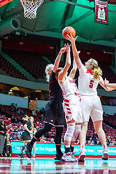 NORMAL, IL - November 20: Gabby Nikitinaite, McKenna Sims and Lexy Koudelka all reach for a rebound during a college women's basketball game between the ISU Redbirds and the Huskies of Northern Illinois November 20 2019 at Redbird Arena in Normal, IL. (Photo by Alan Look)