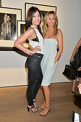 Left to right, DAISY LOWE and ABBEY CLANCY at the Calvin Klein Jeans X mytheresa.com launch the Re-Issue Project at 37 Rathbone Street, London on 17th July 2014.