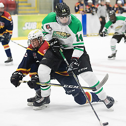 WELLINGTON, ON - SEPTEMBER 7: Riley Mccutcheon #14 of the Cobourg Cougars tries to keep the puck from the defender in the 1st overtime period on September 7, 2018 at Essroc Arena in Wellington, Ontario, Canada. <br /> (Photo by John Lewis / OJHL Images)