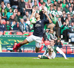 Falkirk's Lyle Taylor tackled by Hibernian's Kevin Thomson.<br /> Hibernian 4 v 3 Falkirk, William Hill Scottish Cup Semi Final, Hampden Park.<br /> &copy;Michael Schofield.