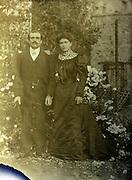 fading portrait of couple posing outside France