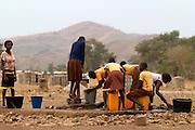 School girls fetching water before school, Ghana.