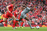 Shola Ameobi of Newcastle United attempts to break through the Liverpool defence during the Barclays Premier League match at Anfield, Liverpool.<br /> Picture by Michael Sedgwick/Focus Images Ltd +44 7900 363072<br /> 11/05/2014