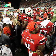 The Louisville Cardinals players celebrate on the field after the NCAA Football Russell Athletic Bowl football game between the Louisville Cardinals and the Miami Hurricanes, at the Florida Citrus Bowl on Saturday, December 28, 2013 in Orlando, Florida. Louisville won the game by a score of 36-9. (AP Photo/Alex Menendez)