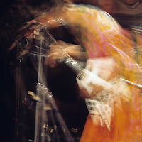"Jimi Hendrix - blurrr.-.In this photograph Charles Everest has succeeded to convey the energy and motion of one of the world's greatest ever guitar players.  .By tracking his movements on stage, and anticipating Jimi's signature gestures, the motion-blur effect was a deliberate and conscious act which sets this image apart from the others captured that evening..In the context of this exhibition, he could almost be morphing into Guy Portelli's sculpture ""Hey Joe"" which was also on display in the exhibition!"